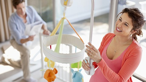 Couple setting up baby room (Obstetrics Landing Page)
