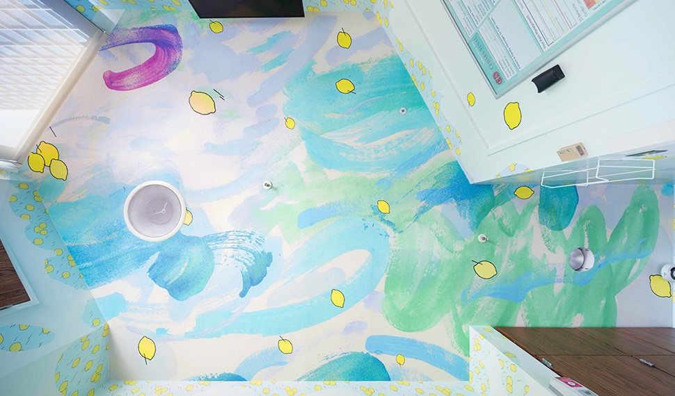 Flying lemons appear to zoom through a swirling sky in artist Laura Owens' wallpaper.   Courtesy the artist; Gavin Brown's enterprise, New York, Rome; Sadie Coles HQ, London; and Galerie Gisela Capitain, Cologne. Photography © Edmund Barr