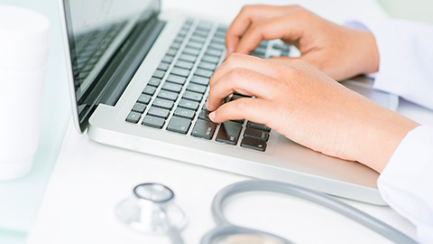(Stock) laptop and Stethoscope