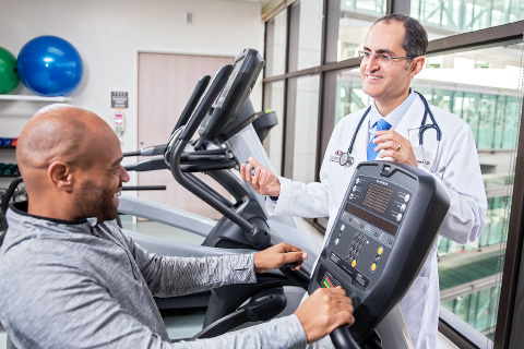 Man working out as doctor watches (Cancer)