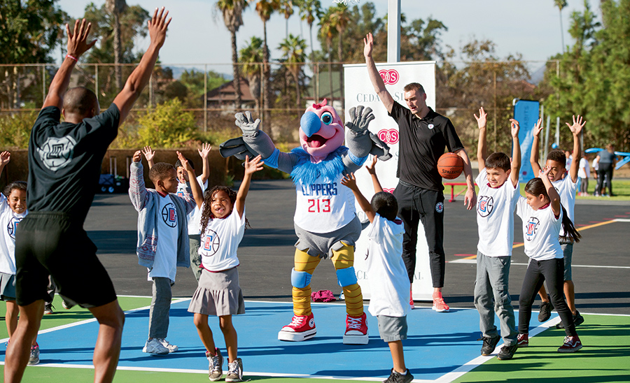 Kids playing basketball with the Clippers