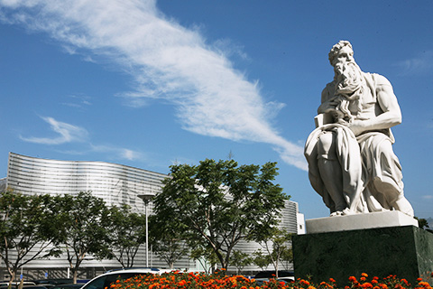 City building and Greek Statue