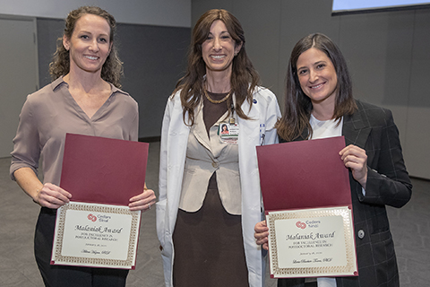 Odelia B. Cooper, MD, director of the Clinical and Translational Research Center, (center) is shown with award winners Adina Hazan, PhD, (left) and Lucia Barbier-Torres, PhD.